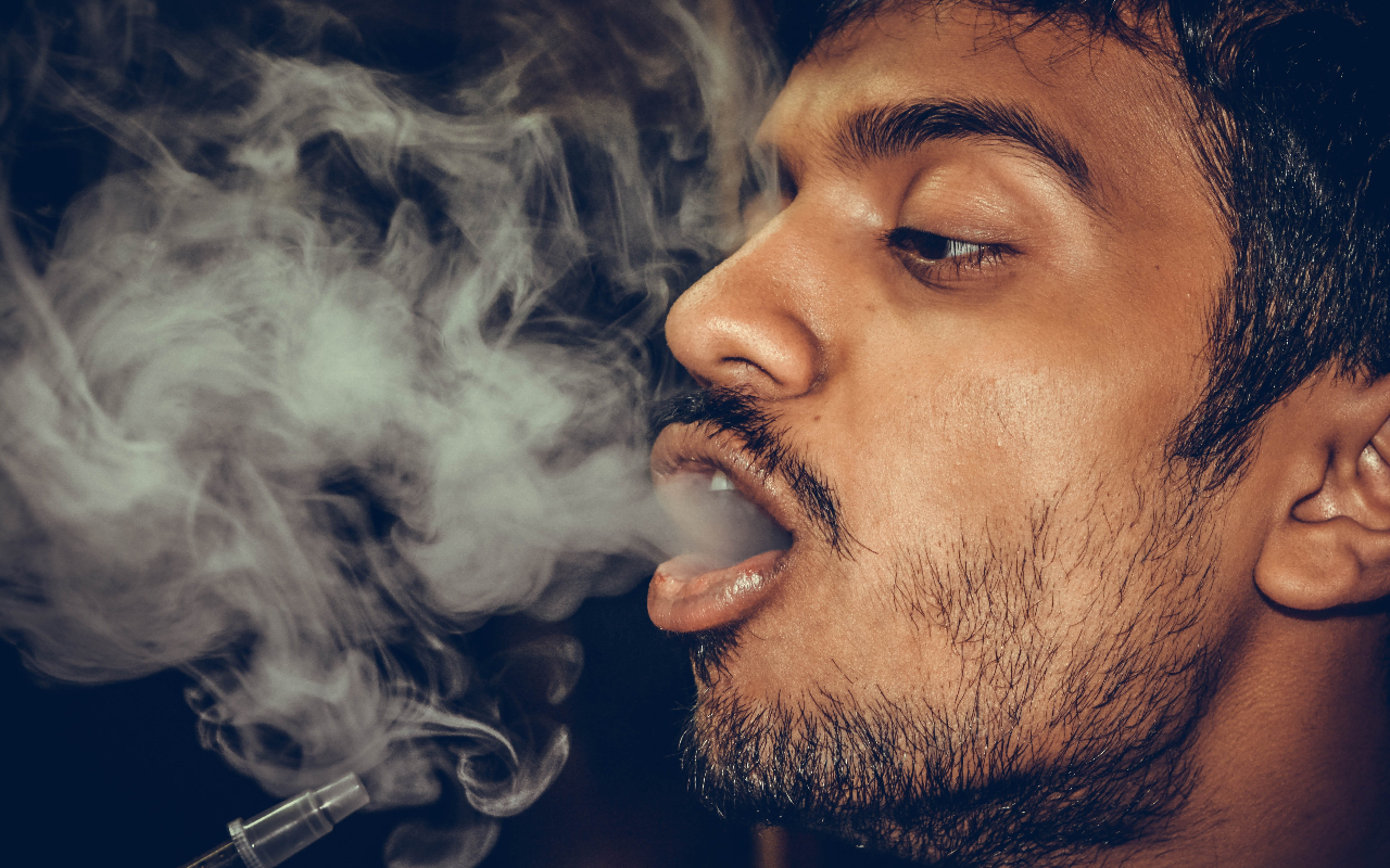 Why Do You Cough After Taking A Hit of Marijuana?
